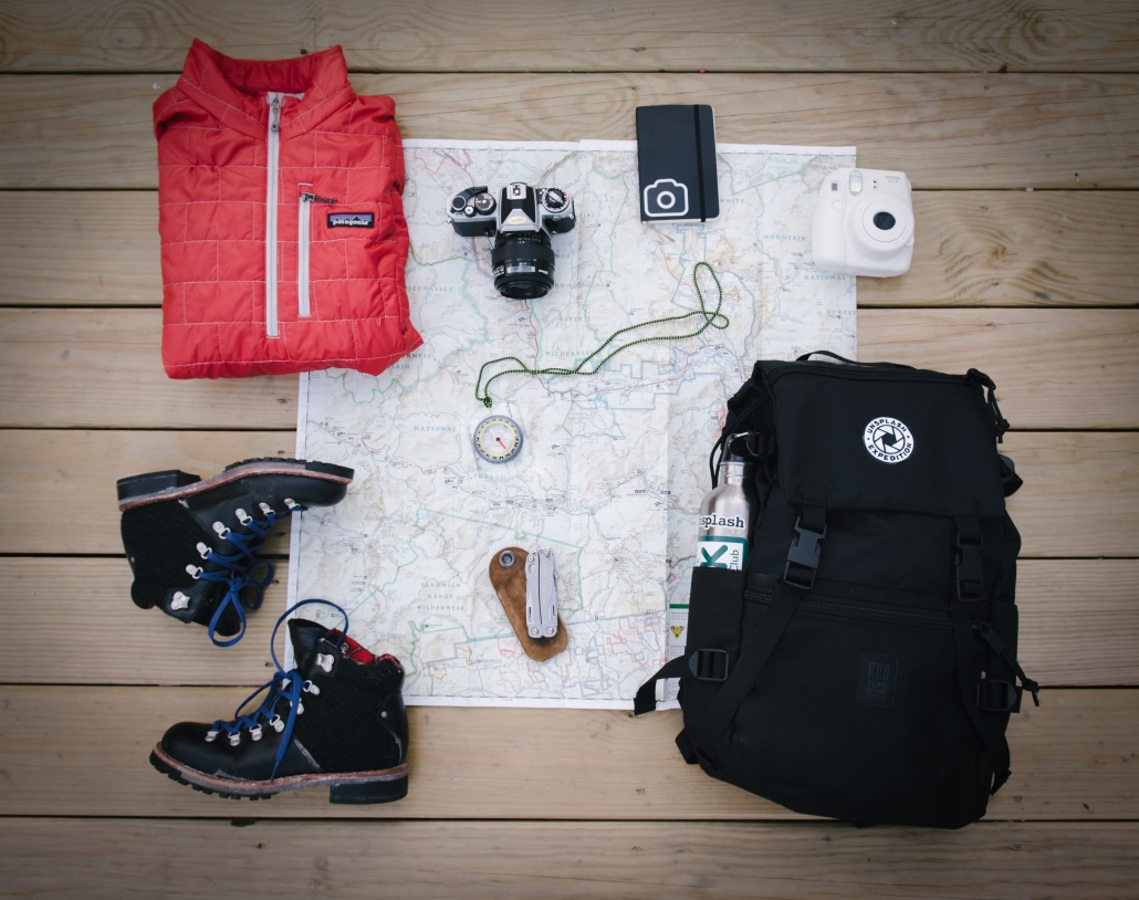 A map with various hiking gear on top of it